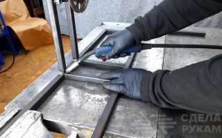 Настенная катушка для шланга из старого колесного диска